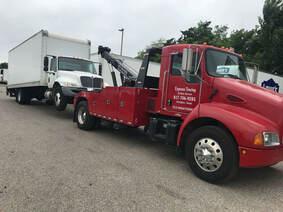 Box truck towing by Express towing